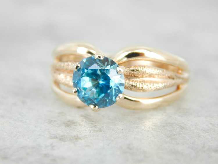 Blue Zircon Gold Solitaire Ring - image 1