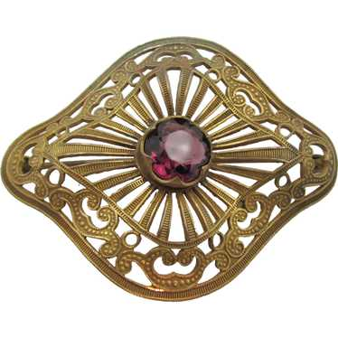 Unique Victorian era snake costume broochpin with amethyst glass and gold colored metal.